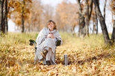 Young woman in autumn, wrapped up against the cold, cool hot tea — Stock Photo