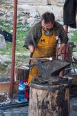Working blacksmith — Stock Photo
