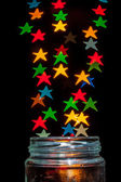 Colorful star shaped bokeh — Stock Photo