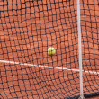 Tennis ball on a clay court — Stock Photo #70599011