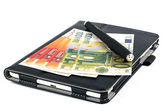 Money tablet and pen — Stockfoto