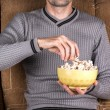Man eats popcorn — Stockfoto #60112487
