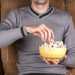 Man eats popcorn — Stock Photo #60112487