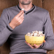 Man eats popcorn — Stockfoto #60112489