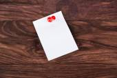Sticker attached pushpin — Stock Photo