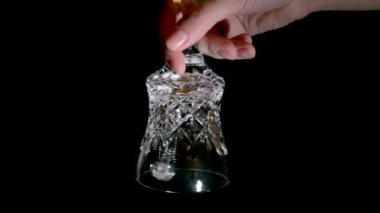 Crystal hand bell on a black background — Stock Video