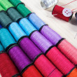 Rainbow of colourful thread spools on the table — Foto de Stock