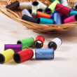 Rainbow of colourful thread spools on the table — Stock fotografie
