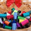 Rainbow of colourful thread spools on the table — Stok fotoğraf