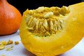 Orange vibrant pumpkin with seeds — Stock Photo