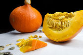 Orange vibrant pumpkin with seeds — Stock Photo