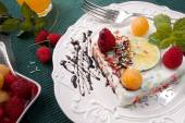 Sweet delicious panna cora dessert with chocolate and raspberries — Stock Photo