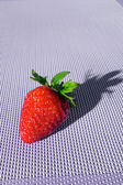 Sweet strawberry on purple textile with shade — Foto de Stock