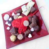 Valentine heart with candies — Stock Photo