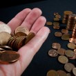 Business and money saving concept - close up of female hand with euro cents and column of money — Stock Photo #56478157