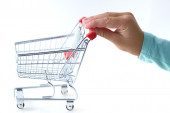 Shopping Cart pushed by a hand — Stockfoto