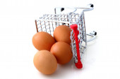 Tilted Shopping Cart tilted with Eggs — Stock Photo