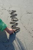 Kids hand writing MOM in the Sand — Stock Photo