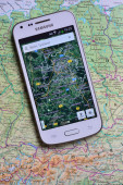 Smartphone on map showing Berlin — Stock Photo