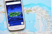 Smartphone on map showing Puerto Rico — Foto Stock