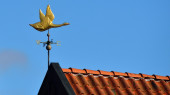 Weathercock on a roof — Stock Photo