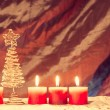 Burning candles with christmas tree on the warm background, chri — Stock Photo #55748251