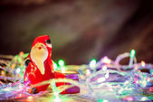 Merry Christmas, santa claus figure on warm blurred background w — ストック写真