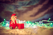 Merry Christmas, santa claus figure on warm blurred background w — Stock Photo