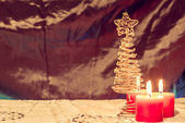 Burning candles with christmas tree on the warm background, chri — Stock Photo