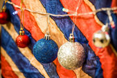 Christmas decoration on multicolour background — Stock Photo