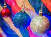 Christmas decoration on multicolour background — Stock Photo
