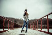 Young pretty girl outdoor on the bridge — Stock Photo