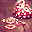 Decoration with red hearts and wedding rings on the wooden backg — Stock Photo #62237051