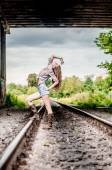 Young girl on the railroad — ストック写真