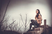 Long hair brunette girl outdoor with old industrial view behind, — Stock Photo