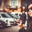 Long hair brunette girl outdoor with city street on background — Stock Photo #69593417