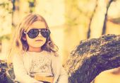 Happy little pretty girl outdoor in the park — Stock Photo