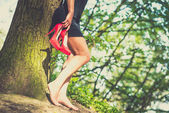 Barefoot brunette girl in black dress outdoor — Fotografia Stock