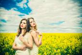 Pretty girls outdoor walking in the field — Stock Photo