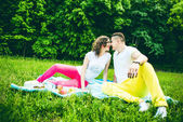 Happy couple relaxing outdoor in the green park — Stock Photo