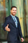 Businessman making handshake — Stock Photo