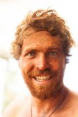 Smiling dirty ginger caveman — Stock Photo