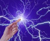 Close-up of human hand clenching lightning flash — Stock Photo