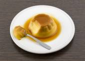 Creme caramel vanilla custard dessert or flan on white dish — Stock Photo