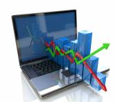 Laptop and business chart — Stock Photo