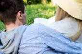 A loving couple reading a book on nature — Stock Photo