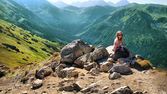 Blond girl practicing trekking in the Polish mountains — Stock Photo