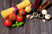 Fresh vegetables and pasta to prepare spaghetti — Stock Photo