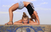 Two, blond, pretty girls are doing contortions — Stock Photo