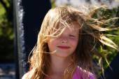 The wind blows the hair of blond girl — Stock Photo
